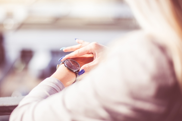woman-checking-the-time-on-her-fashion-watches-picjumbo-com